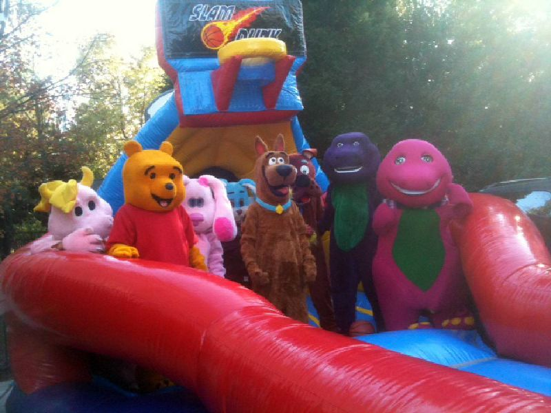 Costumed characters on a bounce house in Cary