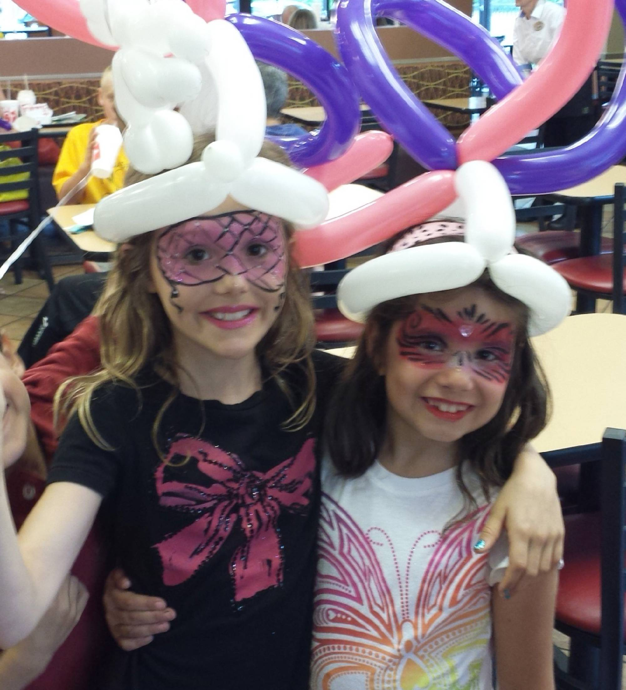 Crazy balloon hats and face painting in Cary NC