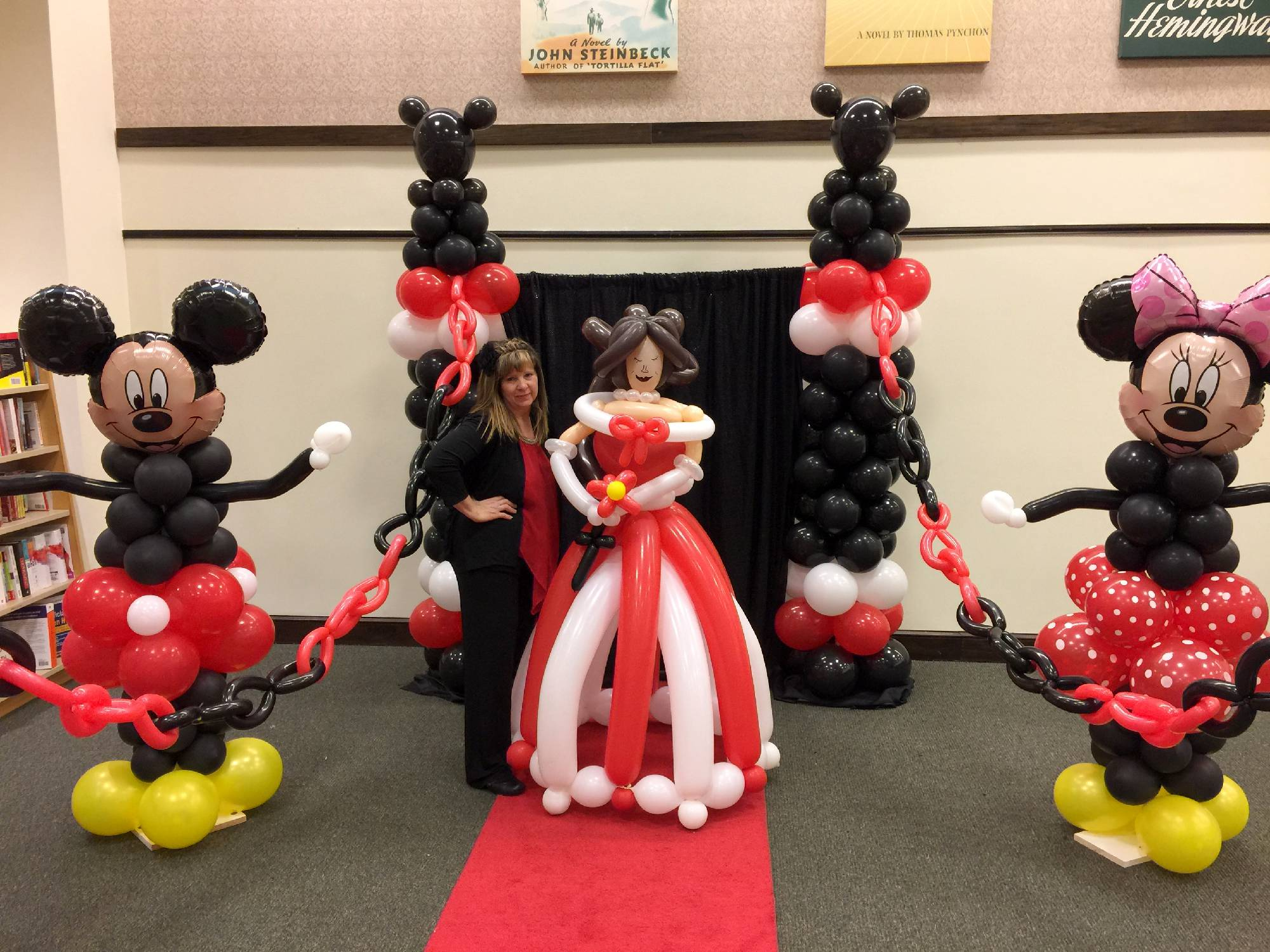 Famous mouse and princess balloon decorations for book store story time