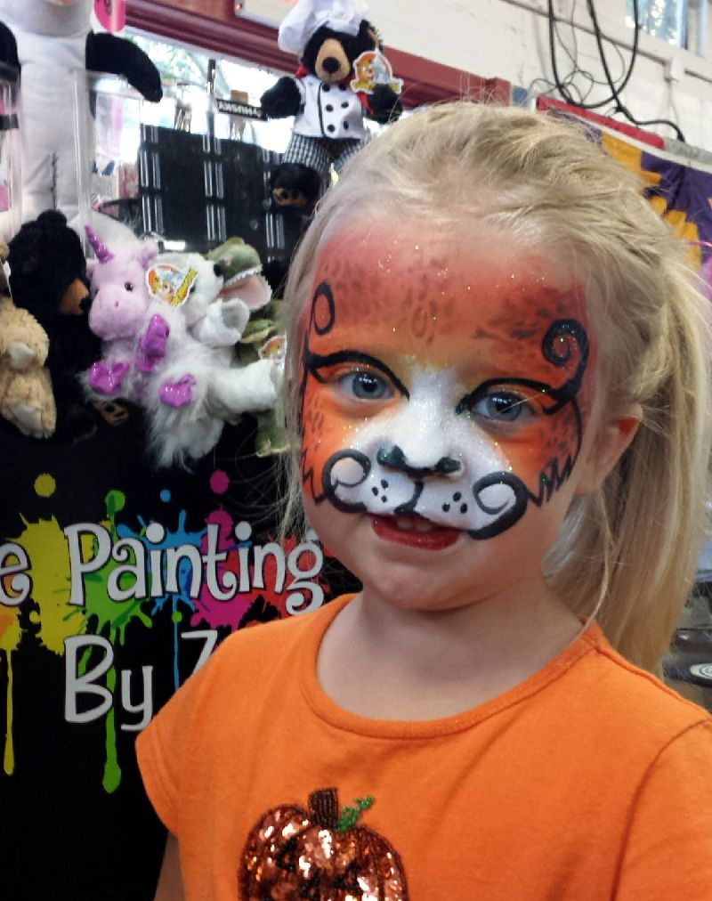 Face painting of orange cheetah girl from the NC State Fair