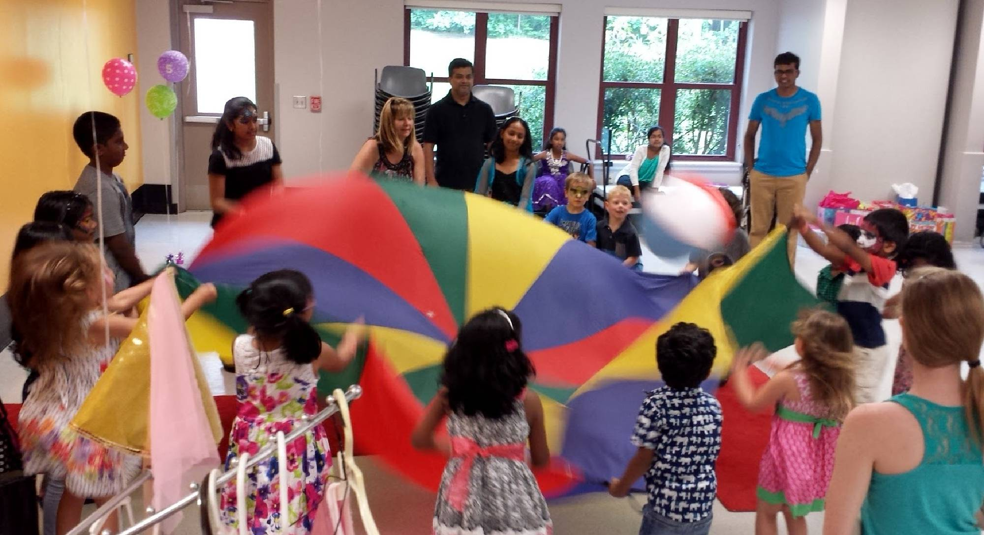 Parachute and games at the Apex Community Center