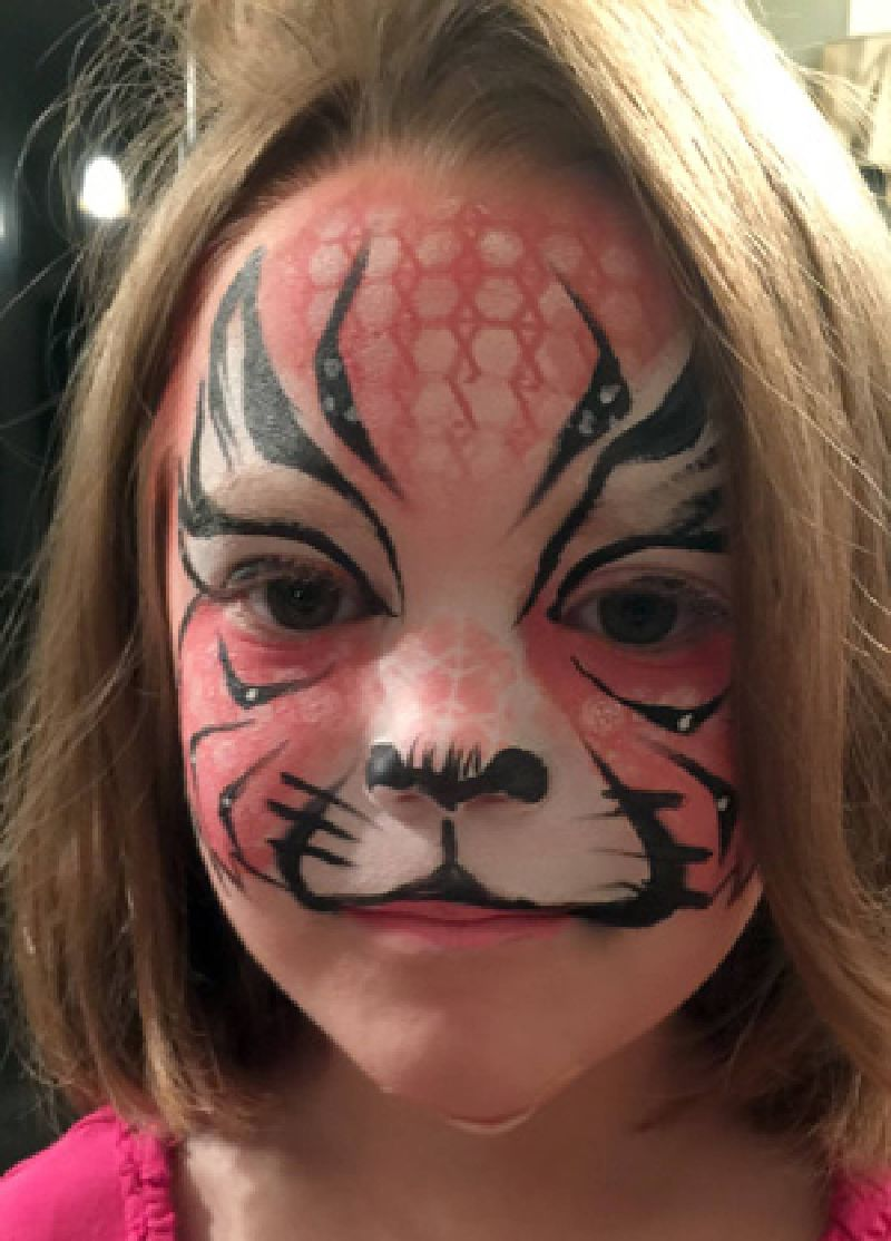 Face painting of pink tiger girl