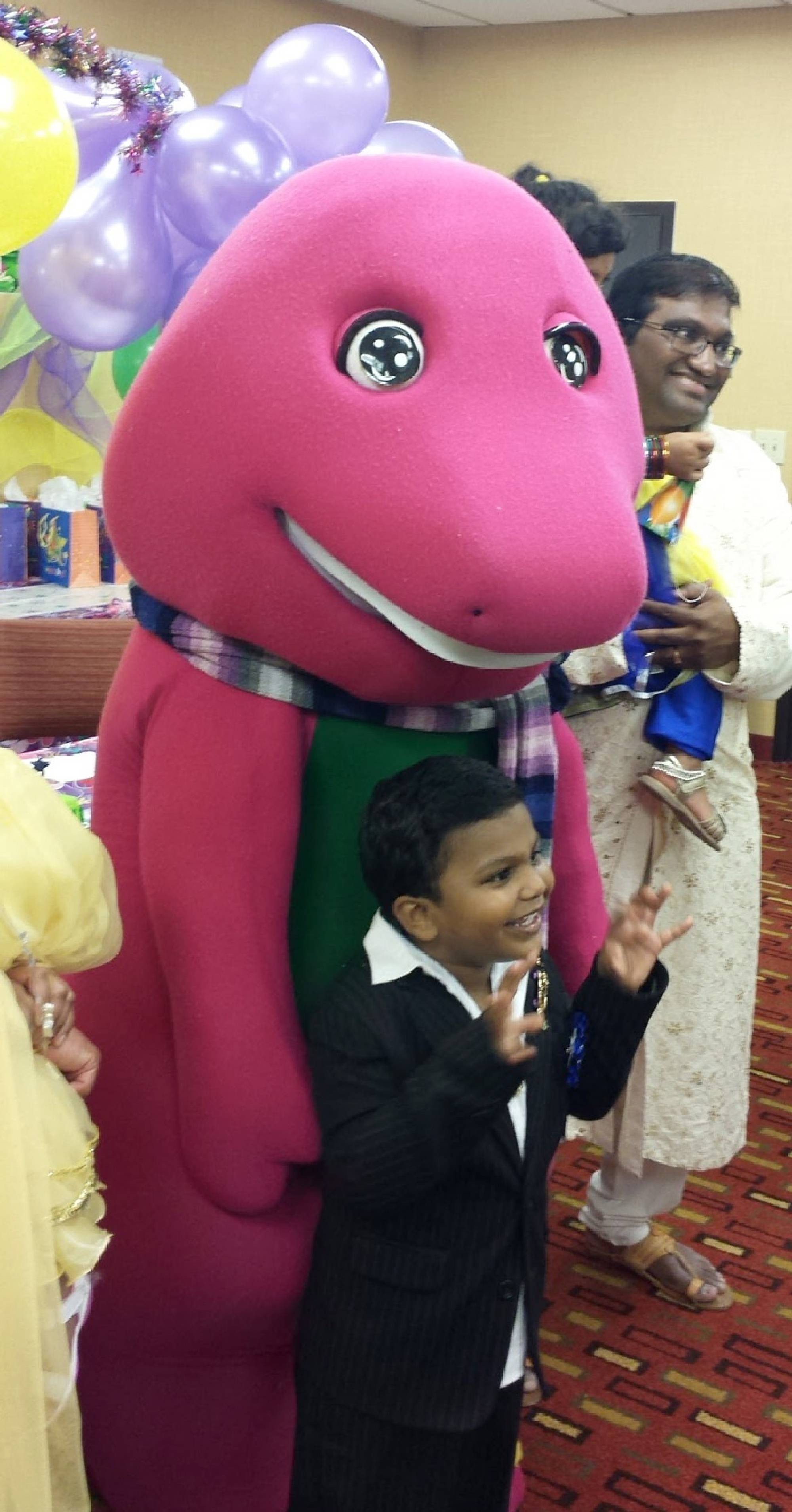 Purple dinosaur costumed character at birthday party in Cary