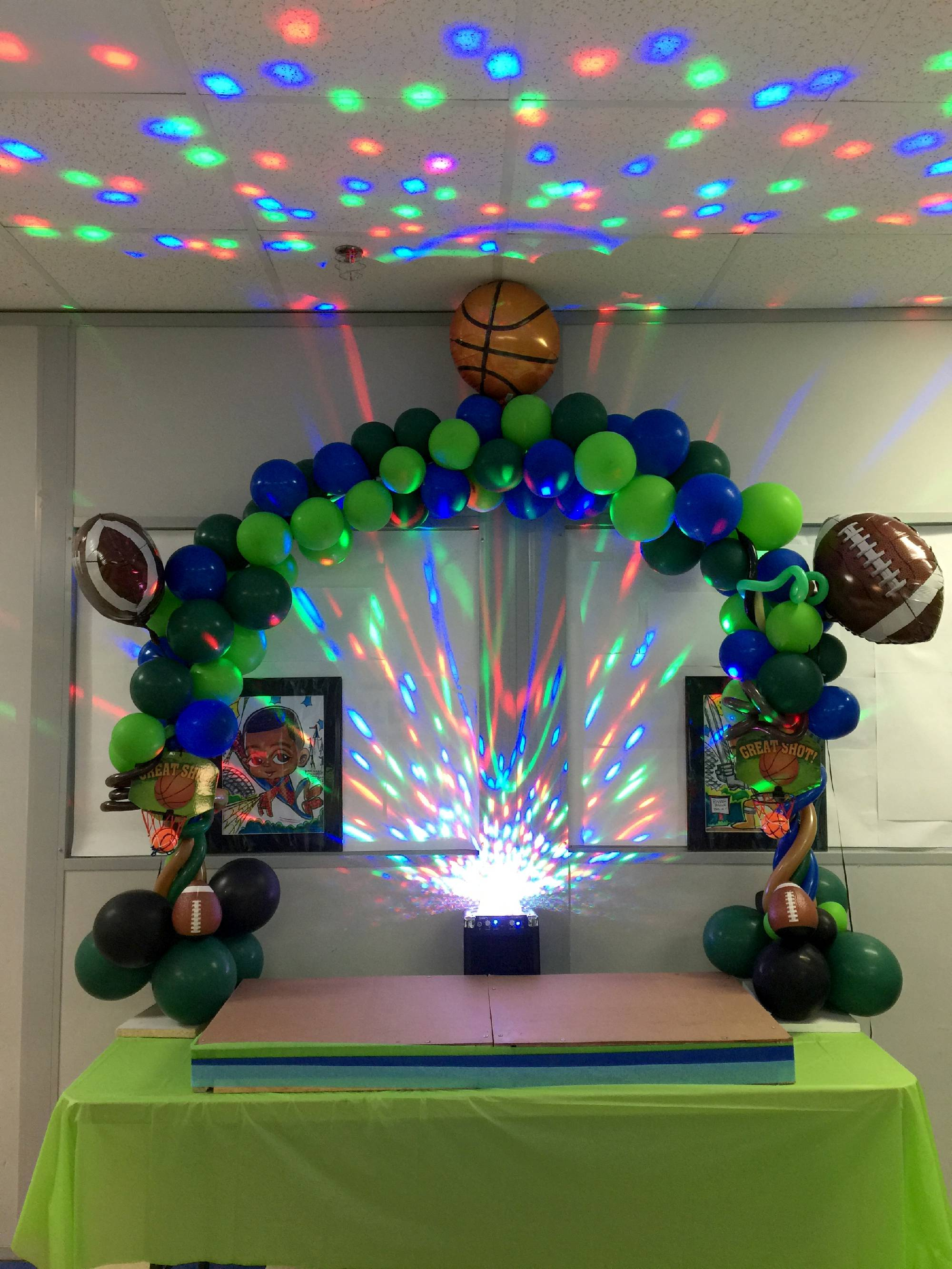 Sports theme balloon table decoration and lights in Apex