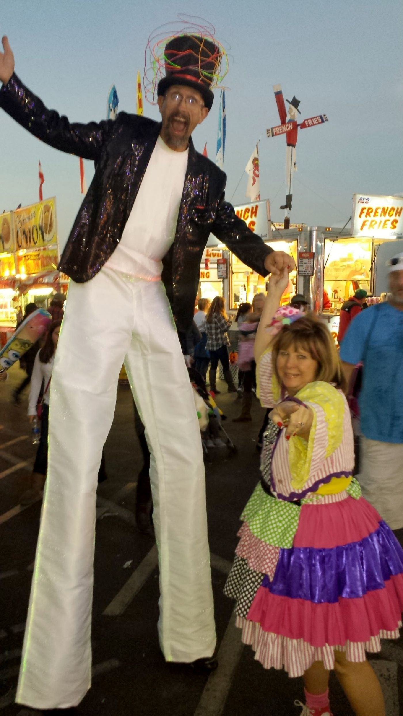 Zoe with a stilt walking friend at the NC State Fair